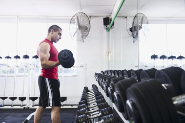 Middle Eastern man exercising with dumbbells