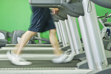 Middle Eastern man walking on treadmill