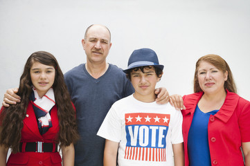Family standing together on with t-shirt that says VOTE