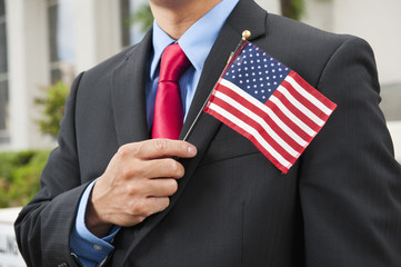 Chinese businessman holding American flag