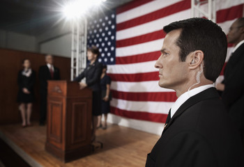 Security guard with earpiece at public speech