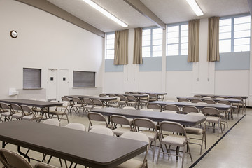 Tables and chairs in empty cafeteria