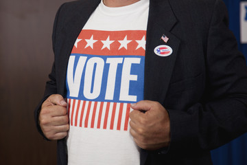 Mixed race voter displaying Vote slogan on t-shirt