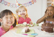 Girls enjoying cake at birthday party