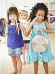 Girls making music with pots and pans