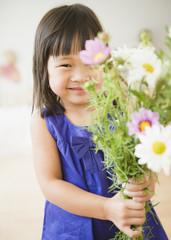 Korean girl holding bouquet of flowers