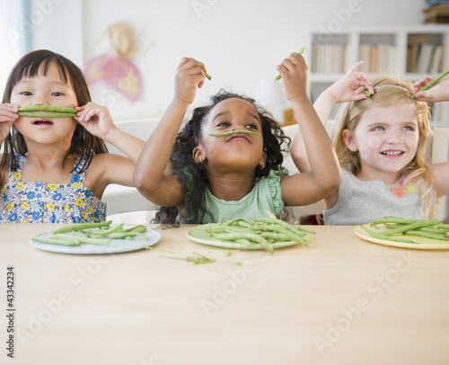 Girls playing with green beans