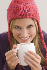 Caucasian woman drinking hot chocolate
