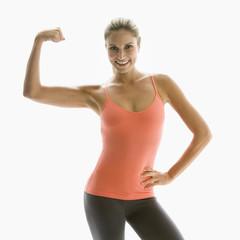 Caucasian woman flexing her muscles