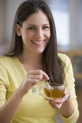 Caucasian woman drinking tea