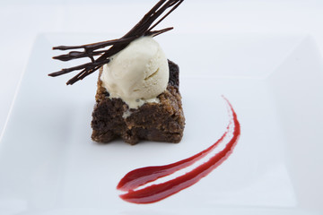 Elegant brownie dessert on plate with ice cream