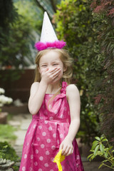 Laughing girl in party hat