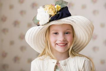 Smiling girl in elegant hat