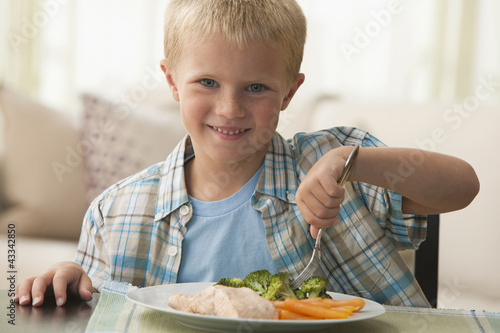 Caucasian boy eating dinner