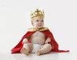 Caucasian baby boy dressed as king