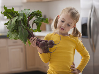 Caucasian girl looking at beets
