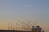 Silhouette of television antennas on rooftop