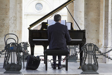 Pianist playing piano outdoors