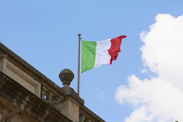 Italian flag fluttering on rooftop