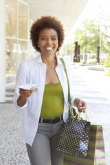 Smiling African American woman shopping