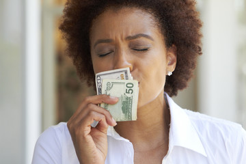 African American woman kissing 50 dollar bill