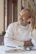 Hispanic chef talking on cell phone in restaurant