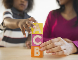 African American mother and son playing with blocks