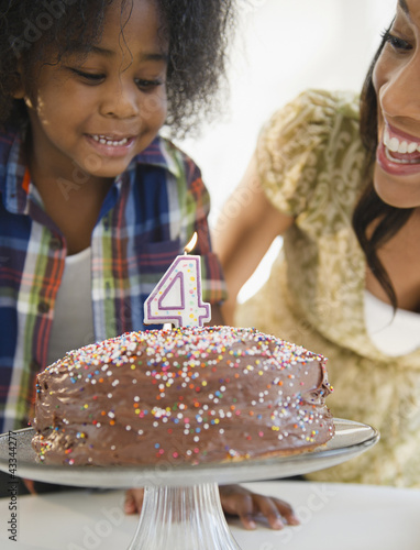 African American mother and son with birthday cake