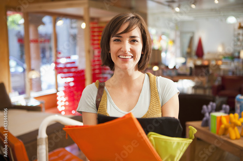 Smiling Hispanic woman shopping in store
