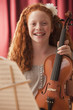 Mixed race girl holding a violin
