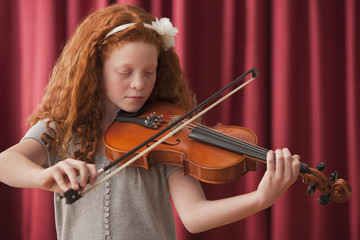 Mixed race girl playing the violin