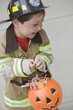 Caucasian boy dressed in fireman Halloween costume