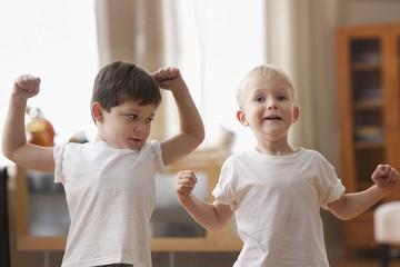 Caucasian boys flexing muscles