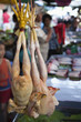 Raw chickens hanging in market