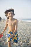 Smiling boy playing on beach