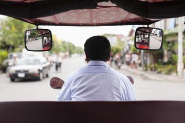 Cambodian rickshaw driver on street