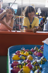 Children playing arcade game in amusement park
