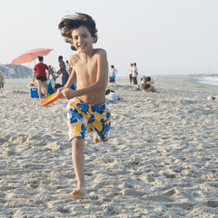 Smiling boy playing on beach