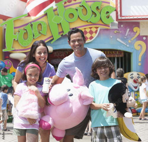 Hispanic family enjoying amusement park
