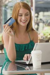Caucasian teenager shopping online with credit card