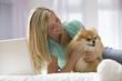 Caucasian teenage girl holding dog