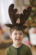 Caucasian boy in antler costume