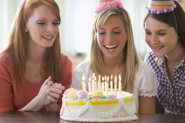 Caucasian teenage girls at birthday party