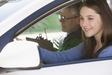 Caucasian teenage girl taking driver's test
