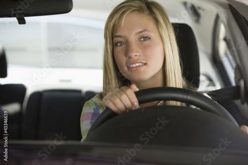 Caucasian teenage girl driving car