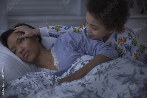 Son waking up sleeping mother