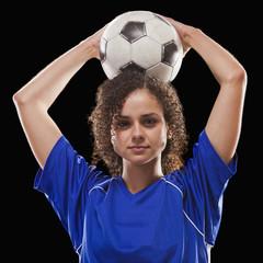 Caucasian soccer player holding ball