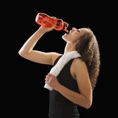 Caucasian woman drinking from water bottle