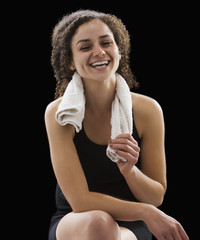 Caucasian woman sitting with towel around her neck