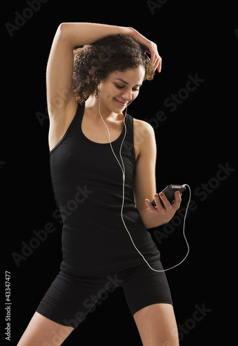 Caucasian woman listening to mp3 player